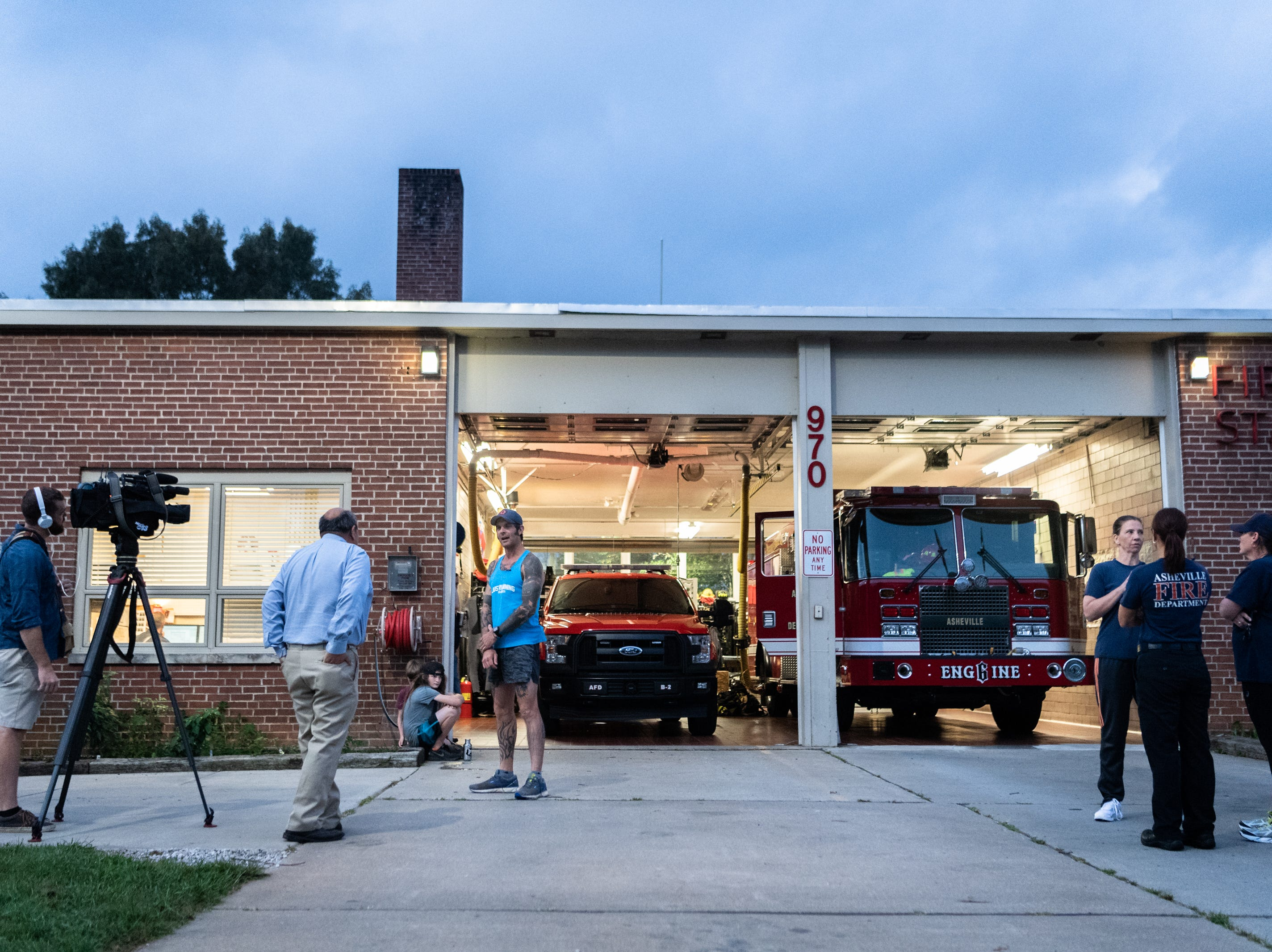Mikey Riley, an Asheville firefighter, is interviewed at station 6 on Haywood Road before beginning his 100k run to Ebbs Chapel and back Oct. 8, 2018. Riley is running one mile for every firefighter who has ever been diagnosed with cancer in an effort to raise awareness of firefighters' higher risk of cancer than the general population.