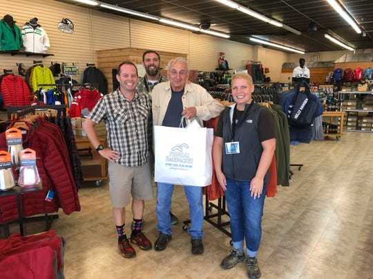 Frugal Backpacker Greenville manager, Mike Geoffrion, and team members, Ann MacDonald and Mike Perry welcome their first customer last week.