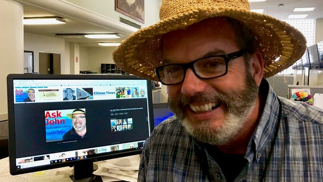 """While the resemblance is striking, John Boyle and John Shore are not the same person. John Boyle, right, trying to look like John Shore in this photo, writes the """"Answer Man"""" column for the Citizen Times. John Shore, left (on the computer screen), writes the """"Ask John"""" relationship advice column for the paper."""