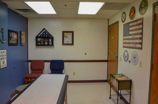 One of the rooms of Battle Creek Family Care that owner and main practitioner Carl Kinzel sees patients in is military-themed, because of Kinzel's own history in the navy.