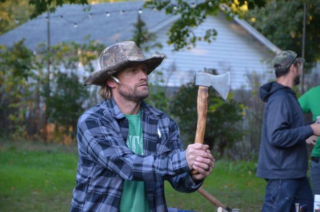 Dustin Wellman prepares to throw his ax during a BTL AXE league night on Thursday, October 4, 2018.