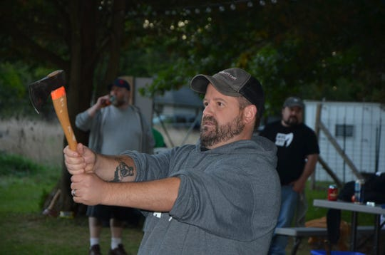 Jeremy Andrews prepares to throw his ax during a BTL AXE league night on Thursday, October 4, 2018.
