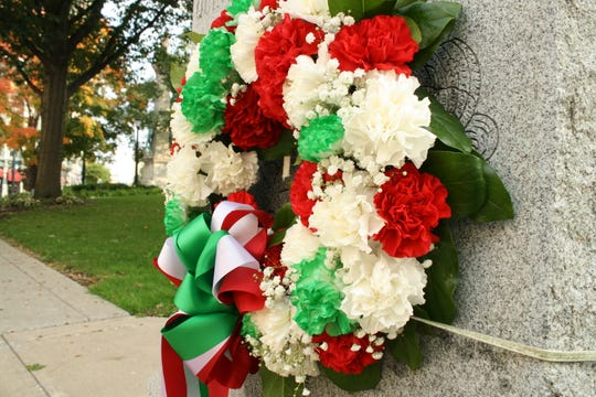 A wreath decorates the statue of Christopher Colmbus in downtown Binghamton on Monday morning. Columbus Day festivities in Binghamton began with an Italian flag raising outside of Binghamton City Hall, followed by the annual Parade and Tournament of Marching Bands. An Italian Festival was held on Water Street into the afternoon.