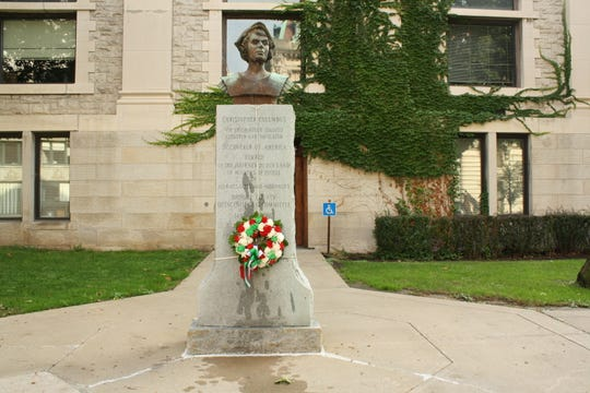 A wreath, hung by members of the Sons of Italy Lodge #487 and Duca Degli Abruzzi Lodge #443, decorates the statue of Christopher Columbus in downtown Binghamton on Monday.