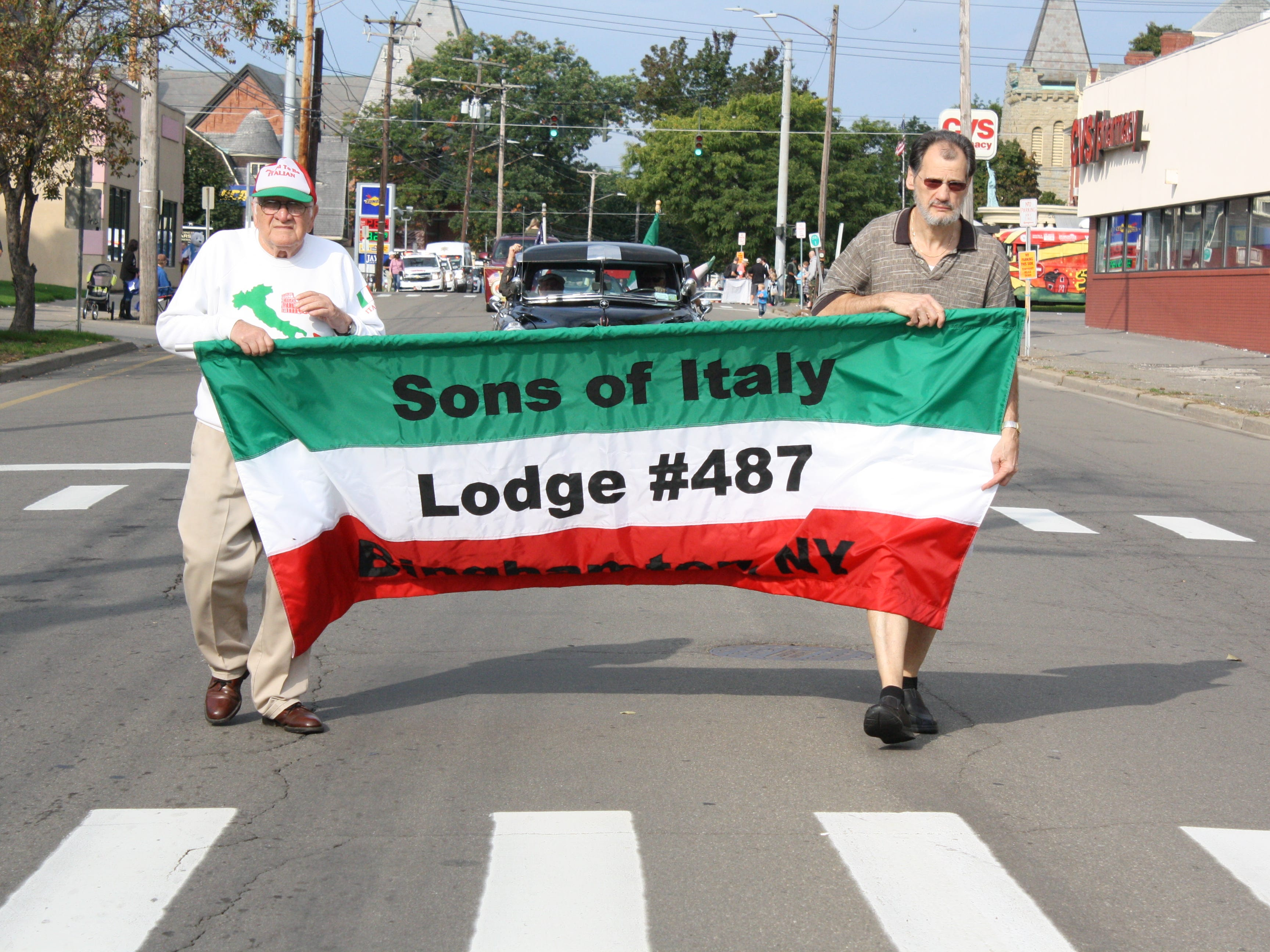 Columbus Day festivities in Binghamton began with an Italian flag raising outside of Binghamton City Hall Monday morning, followed by the annual Parade and Tournament of Marching Bands. An Italian Festival was held on Water Street into the afternoon.