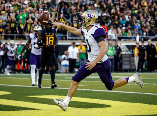 Washington quarterback Jake Browning (3) flips the ball away after scoring a touchdown against Oregon on Oct. 8, 2016. The Huskies won that game, 70-21, ending a 12-game losing streak to the Ducks.