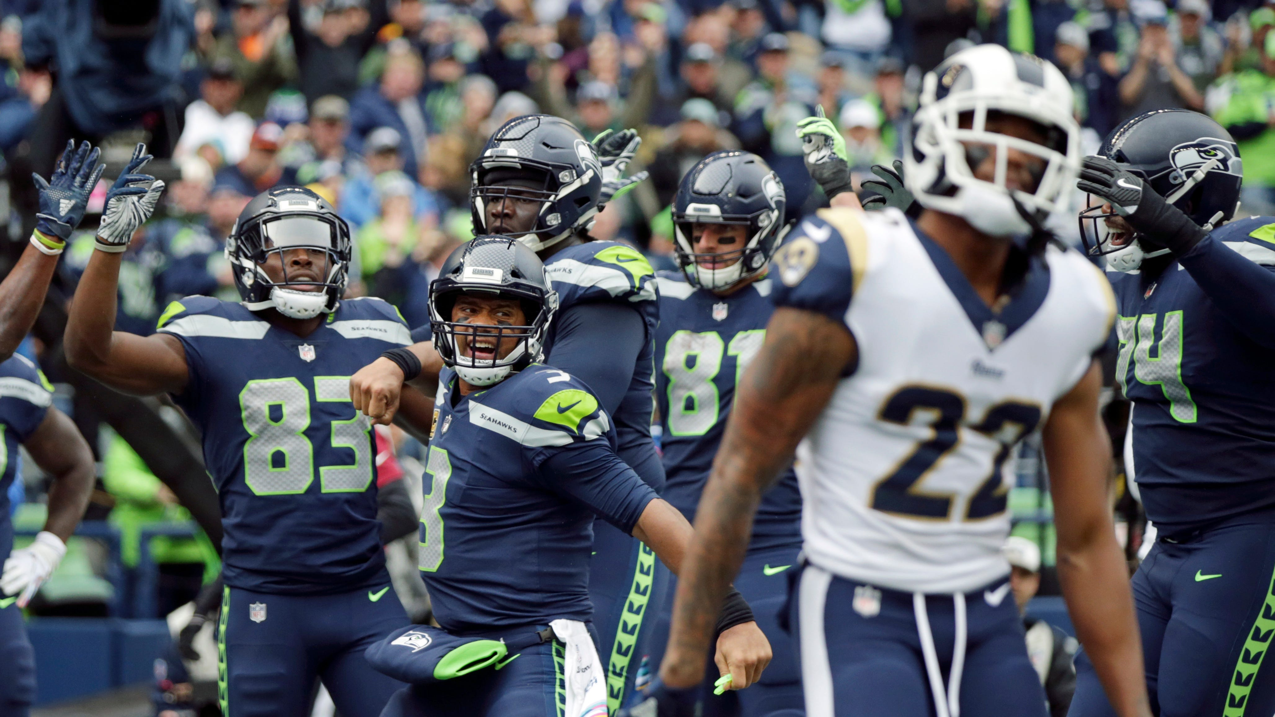 Seahawks quarterback Russell Wilson threw three touchdown passes in Sunday's loss to the Los Angeles Rams.