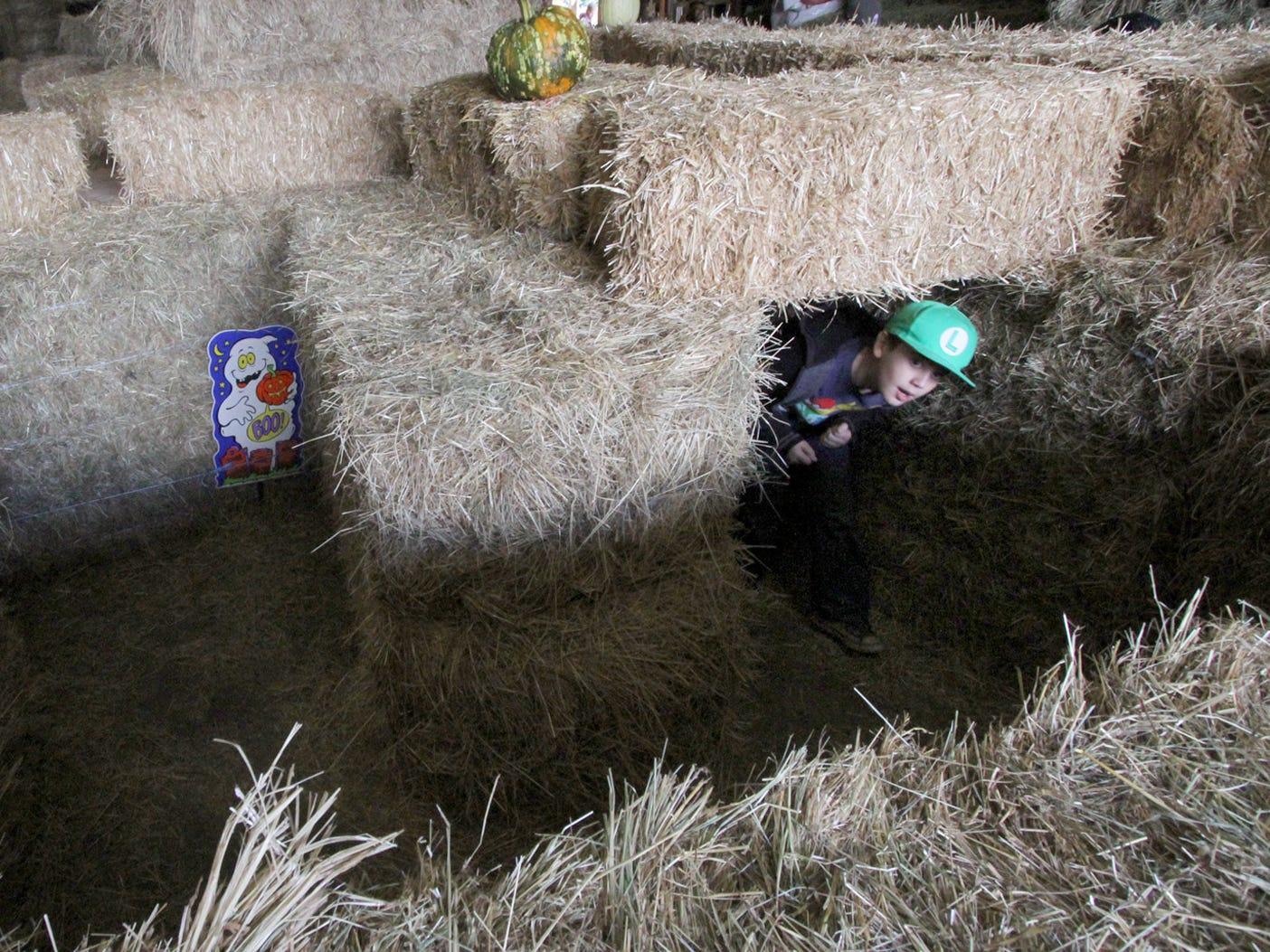 Kids enjoy the hay bale maze at Hunter Farms.