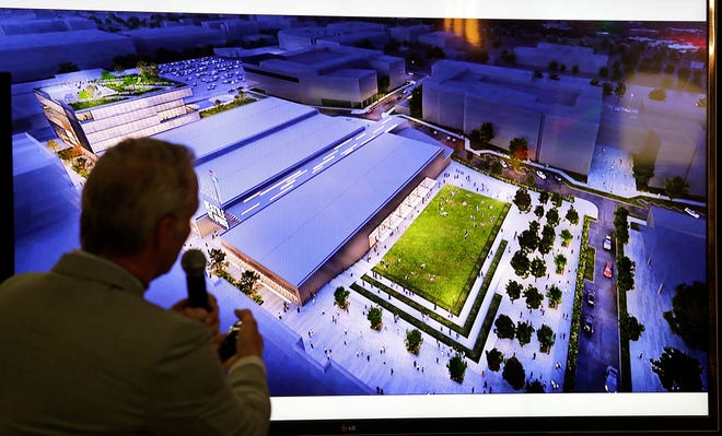 Lance Lopes, project manager for NHL Seattle, discusses renderings of a planned NHL practice facility at Northgate Mall during a news conference Monday in Seattle. The $70 million-plus, 180,000-square-feet facility will include three ice rinks for use by the new team and the public.