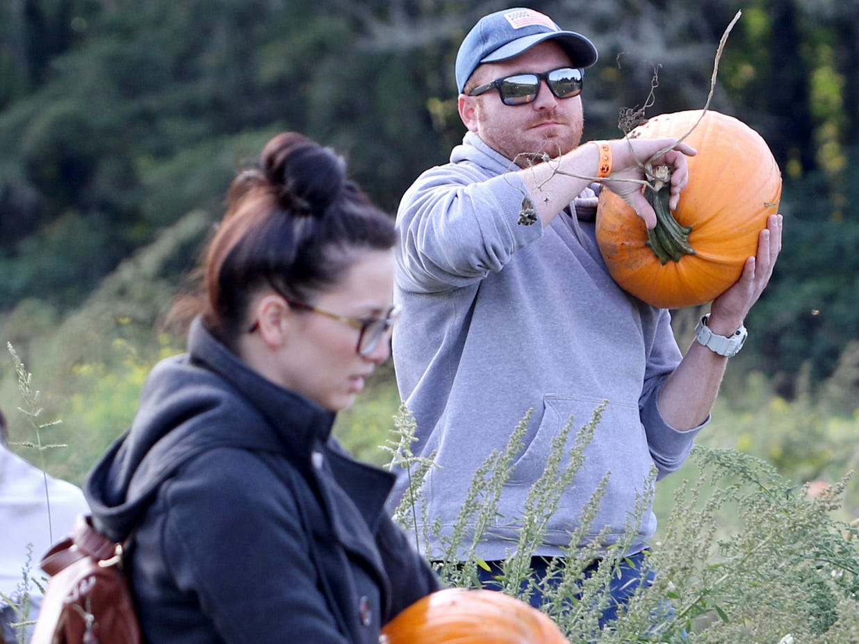 Hunter Farms pumpkin hunters leave the field with pumpkins of their choice.