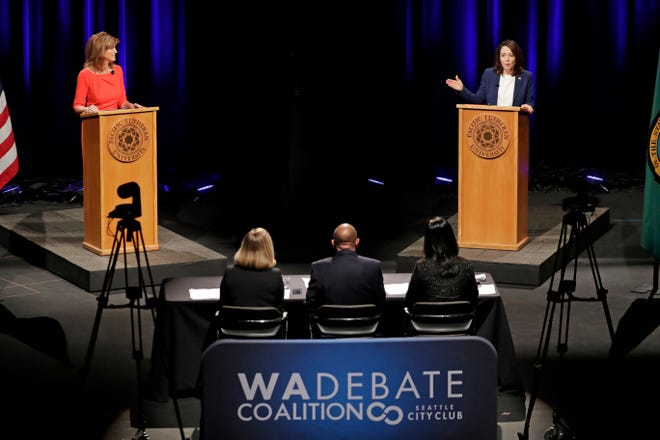Republican Susan Hutchison, left, and Sen. Maria Cantwell, D-Wash., debate Monday at Pacific Lutheran University in Tacoma.