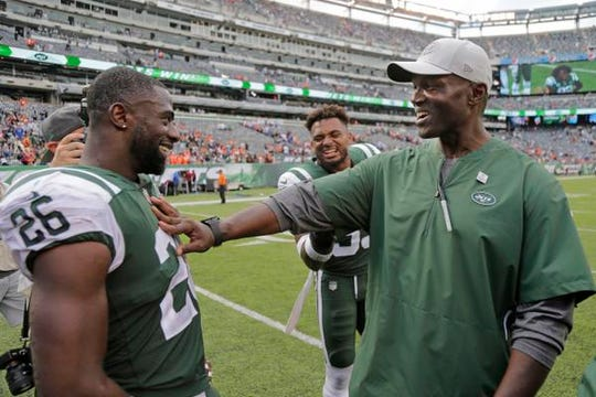 New York Jets head coach Todd Bowles, right, smiles while talking to Marcus Maye (26) after an NFL game against the Denver Broncos Sunday, Oct. 7, 2018, in East Rutherford, N.J. The Jets won 34-16.