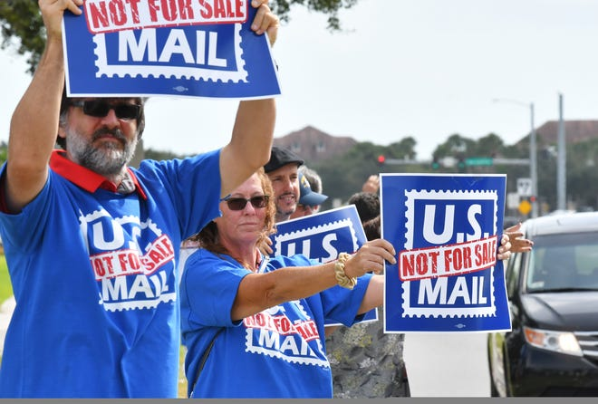 Postal union workers rallied in Viera Monday to protest the proposal to privatize the U.S. Postal Service.