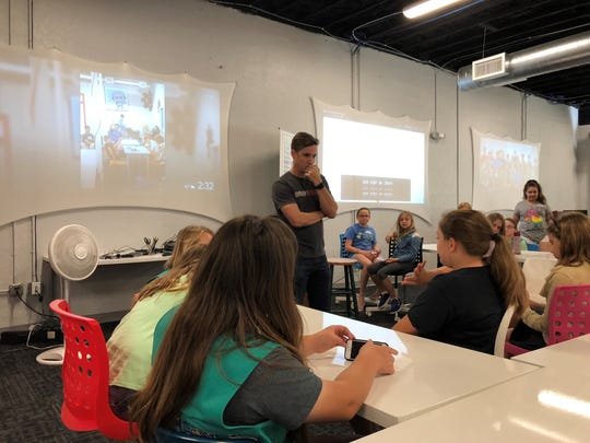 Jordan Wiens, a founder of Vector 35, helped Girl Scouts last Satury earn merit badges in cyber security.