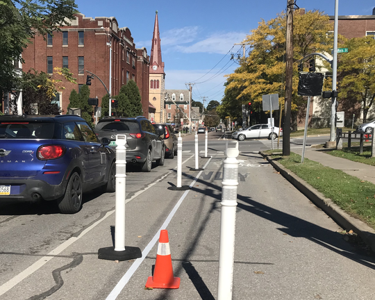 "North-bround cars squeeze into a single lane on South Union Street at its intersection with Main Street in Burlington. A temporary (""pop-up"") bicycle lane prompted the traffic shift on Octl. 5, 2018."