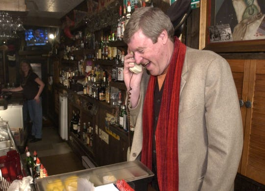 University of Vermont head basketball coach Tom Brennan takes a congratulatory phone call from Senator Patrick Leahy at The Rusty Scuffer in Burlington after the NCAA tournament pairings were announced in 2005, before UVM upset Syracuse in the opening round.