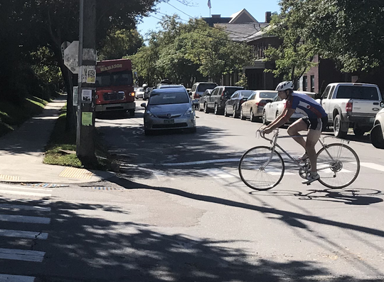 A cyclist pedals east at Maple and South Union streets on Friday, Oct. 5, 2018.