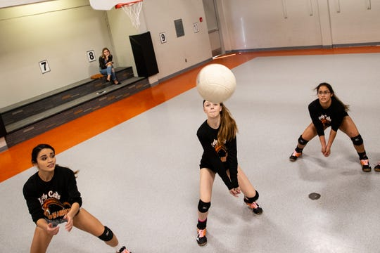The Refugio High School volleyball team run drills as they practice in the elementary school gym on Thursday, Oct. 4, 2018.