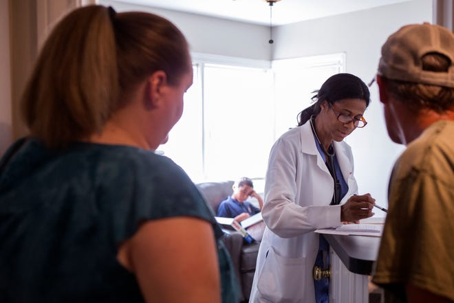 Connie Mouton (left) and Kevin Mouton (right) check out from a visit with Dr. Jimie Owsley at the recently opened community-run medical clinic for people without insurance. The People's Clinic on Morgan Street is $15 per visit or 15 minutes of volunteer work. Owsley has worked in trauma clinical care and is a trauma surgeon, but has always had a dream to open a clinic for people in need.