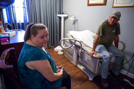 Connie and Kevin Mouton visit the The People's Clinic on Morgan Street on Monday, October 8, 2018. The clinic recently opened for individuals without insurance is $15 per visit or 15 minutes of volunteer work.