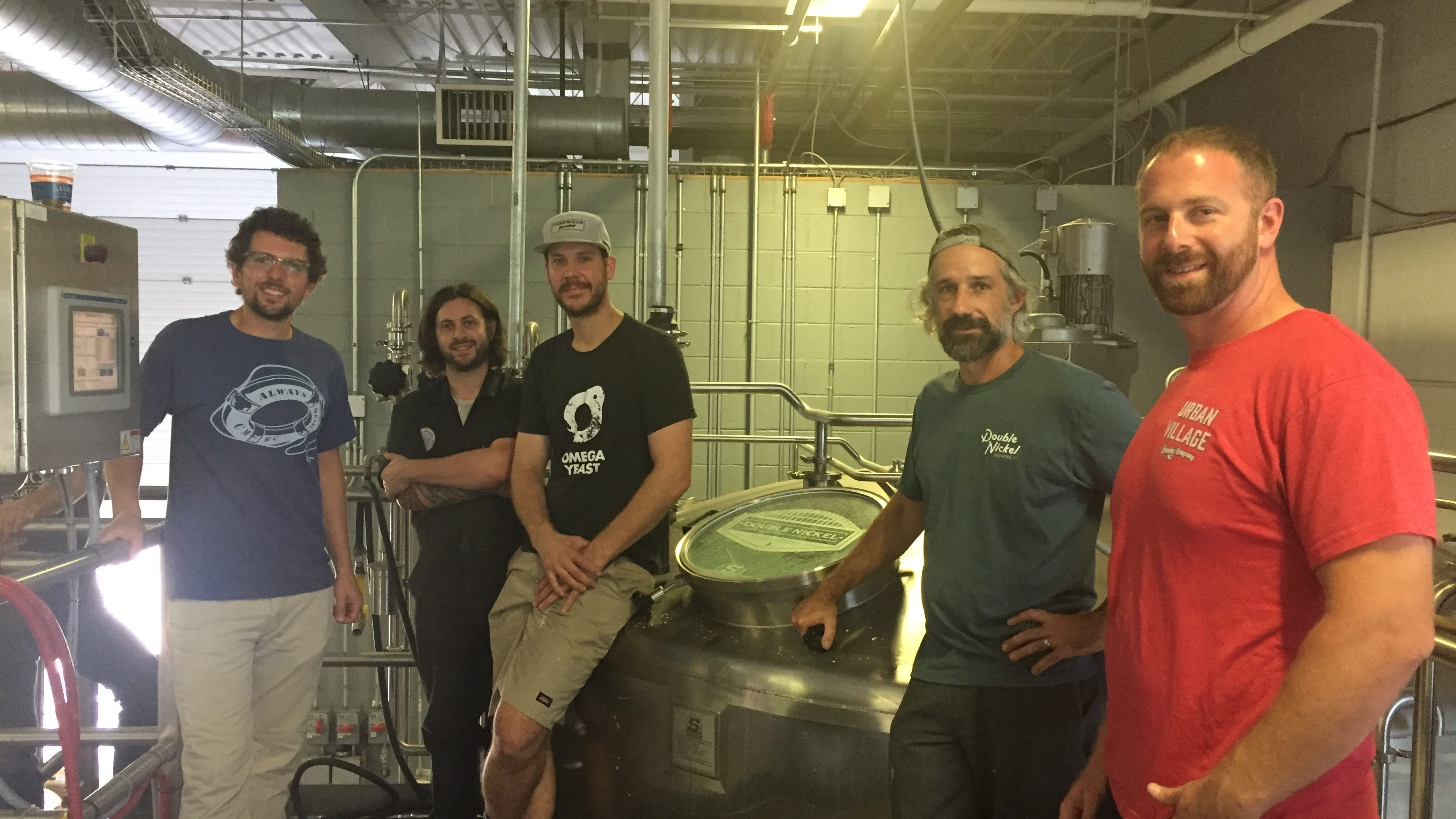 Friendsgiving Hazy IPA brewers gather at Double Nickel Brewing Company in Pennsauken, surrounded by brewery equipment. From left: Chris  Henke of Cape May Brewing; J.T. Melvin of Double Nickel; Eli Facchinei of Tonewood Brewing; Drew Perry of Double Nickel, and Dave Goldman of Urban Viillage Brewing.