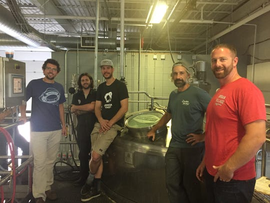 Friends Giving Hazy IPA brewers gather at Double Nickel Brewing Company in Pennsauken, surrounded by brewery equipment. From left: Chris Henke of Cape May Brewing; J.T. Melvin of Double Nickel; Eli Facchinei of Tonewood Brewing; Drew Perry of Double Nickel, and Dave Goldman of Urban Viillage Brewing.