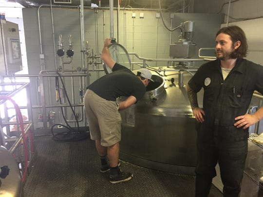 Eli Facchinei, co-founder of Tonewood Brewing Company checks in the hot liquor tank early in the Friends Giving Hazy IPA process. He is joined by J.T. Melvin, assistant brewer at Double Nickel.