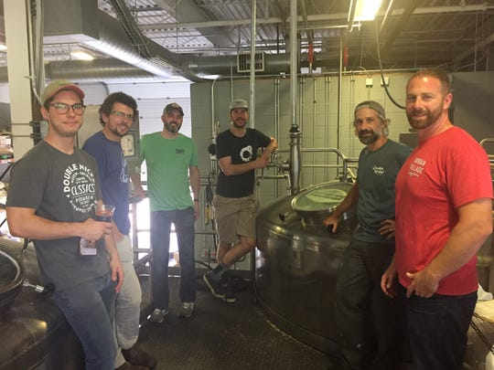 Friends fighting hunger: Representatives of four area breweries gather in the Double Nickel brewhouse shortly after beginning the brewing process for Friends Giving Hazy IPA, a collaborative brew. Proceeds will go to three area organizations working with food insecure residents. Pictured from left are: John Dalsey, Double Nickel; Chris Henke, Cape May; Brian Needham, Double Nickel; Eli Facchinei, Tonewood; Drew Perry, Double Nickel, and Dave Goldman, Urban Village.