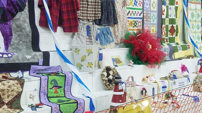 Exhibit by Boone County Extension Homemakers Association at the Boone County Fair on Aug. 7, 2018. The exhibit shows the variety of projects that the homemakers produce.