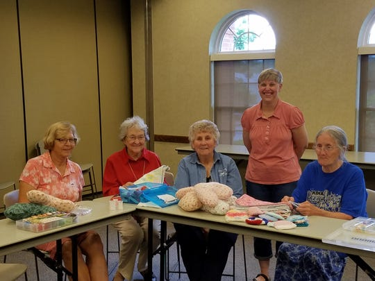 Boone County Extension Homemakers members make baby blankets and cancer caps on April 2, 2018. From left:  Virginia Yahl, Florence; Ray Beasley, Florence; Judy Keeger, Independence; Shannon Carlin, Union; and Mary Neal, Union.