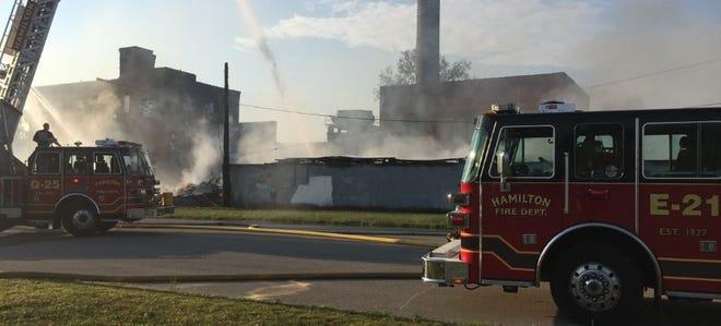 A fire engulfed a warehouse on Joe Nuxhall Boulevard Monday morning.