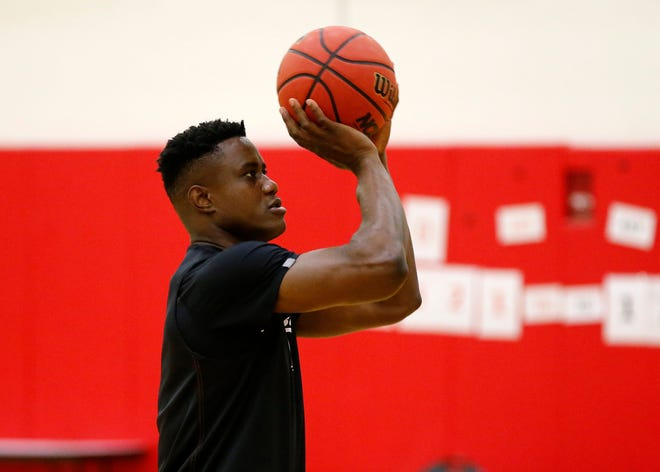 Freshman forward Prince Gillam Toyambi shoots during the University of Cincinnati basketball media day in the practice gym of the Lindner Center at UC in the University Heights neighborhood of Cincinnati on Monday, Oct. 8, 2018.