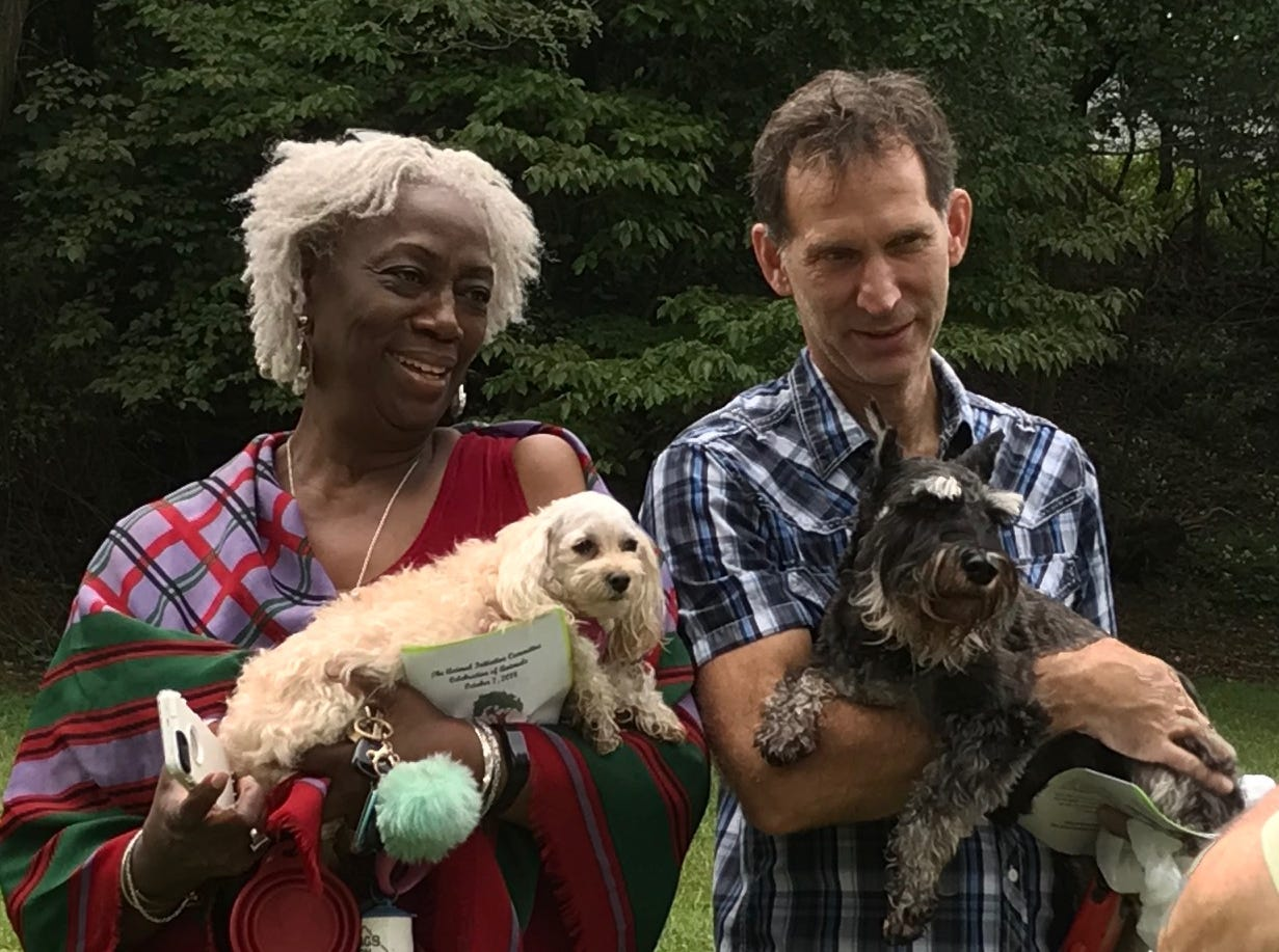 These two people posed with their dogs during the Animal Initiative Commitee's Celebration of Animals Sunday at Leland Avenue Park in Plainfield.