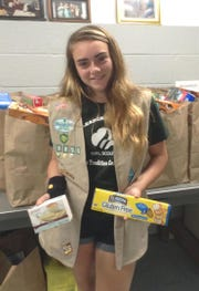 "Emily Chase is an eighth grader at Von E. Mauger Middle School and a Girl Scout with Troop #60850 in Middlesex.  For her Silver Award, Emily worked to provide ""Safe Foods 4 All"", her campaign to collect gluten and allergy free foods for the Fish Food Pantry."