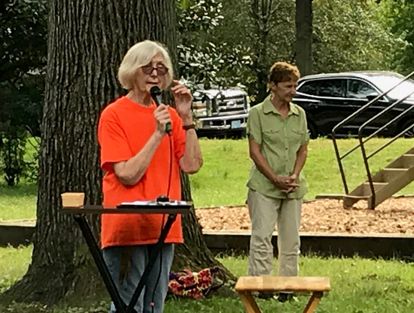 MaryEllen Chanda welcomes pet owners  to Sunday's Animal Initiative Committee's Celebration of Animals at Leland Avenue Park in Plainfield