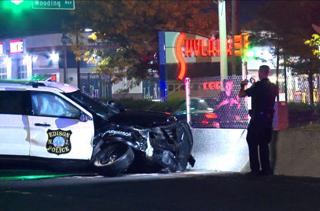 The investigation continues early Monday morning, October 8, 2018, at the scene of a collision between an Edison police vehicle and another car at Route 1 and Wooding Avenue in the township.