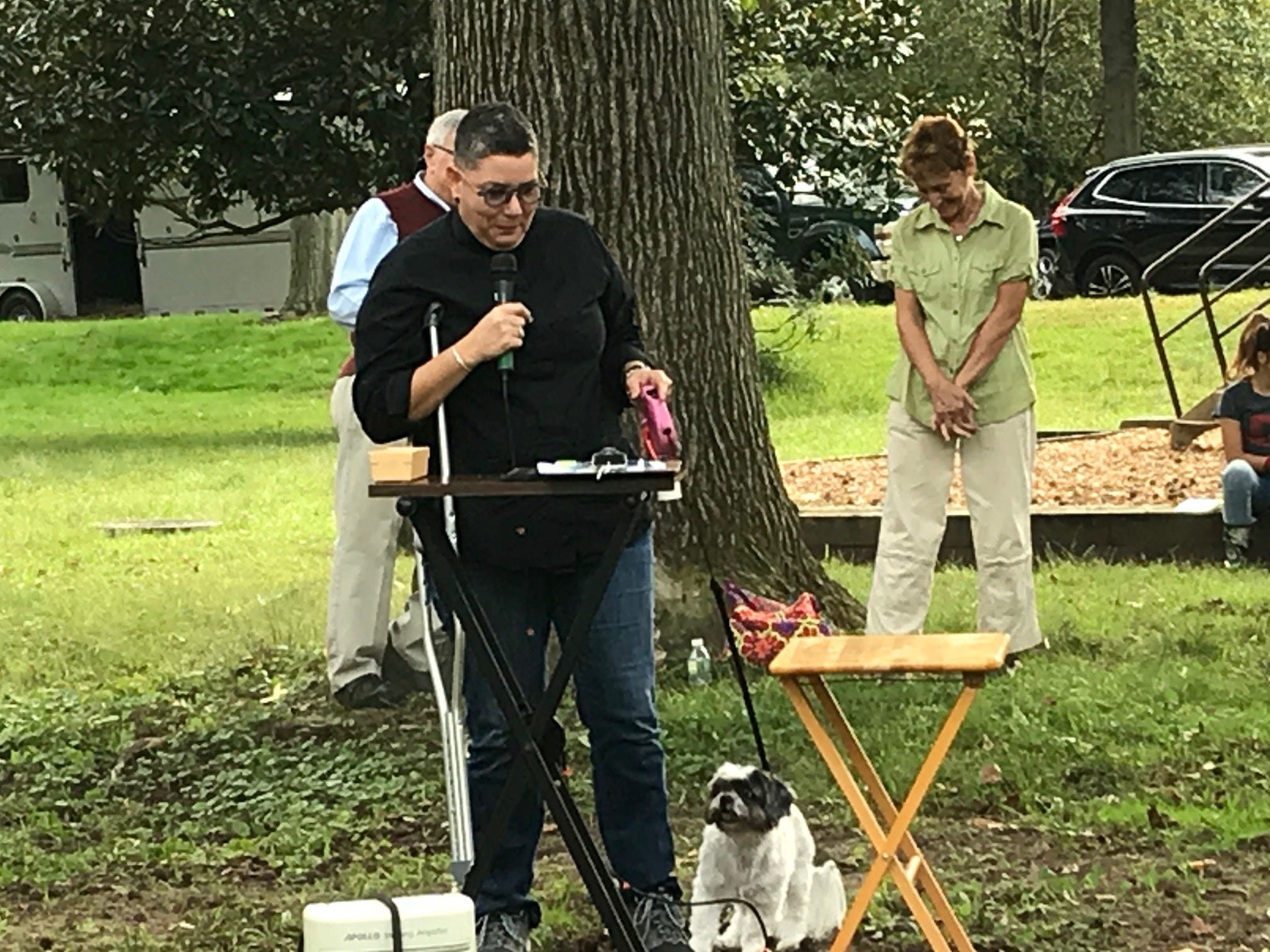The Rev. Demaris Ortega offers a blessing during Sunday's Animal Initiative Committee's Celebration of Animals at Leland Avenue Park in Plainfield