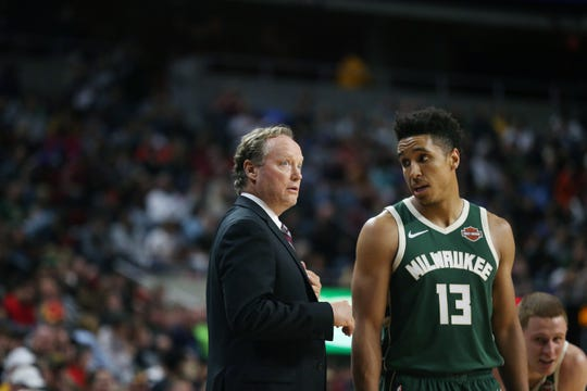 Milwaukee coach Mike Budenholzer talks to Milwaukee's Malcolm Brogdon during the preseason match-up between the Minnesota Timberwolves and the Milwaukee Bucks on Sunday, Oct. 7, 2018, in Hilton Coliseum in Ames, Iowa.