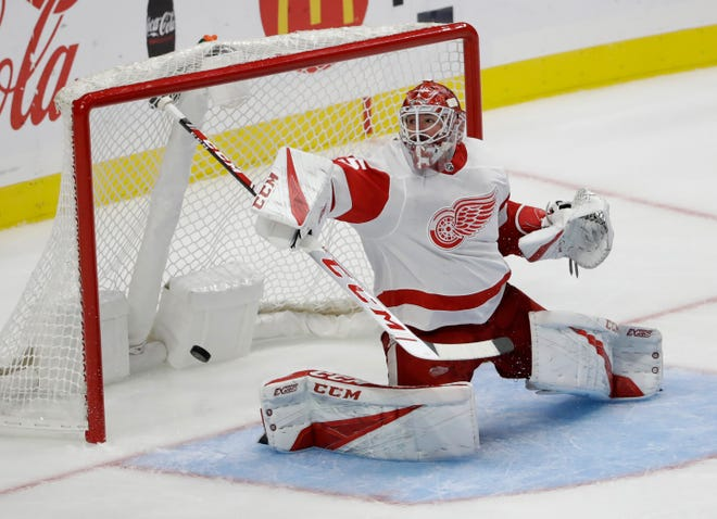 Red Wings goaltender Jonathan Bernier gives up a goal on a shot from the Kings' Alex Iafallo during the third period Oct. 7 in Los Angeles.