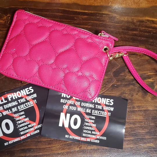 Cards that reiterate the strict no cell phone policy were handed out to fans at the Oct. 5, 2018, Kevin performance at Little Caesars Arena. Paul Wisner III, of Toledo, said security mistook his wife's pink clutch (pictured) as a phone and they were kicked out.
