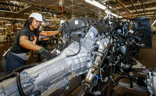 Natasha McAlister works on the assembly line at the General Motors Arlington Assembly Plant Tuesday, July 14, 2015, as GM announces a $1.4 billion investment for upgrades at the plant in Arlington, Texas. The investment allows the plant to be reconfigured with a new paint shop, as well as upgrades in the body shop and general assembly area to more competitively produce high-quality full-size SUVs. (Photo by Mike Stone for General Motors)