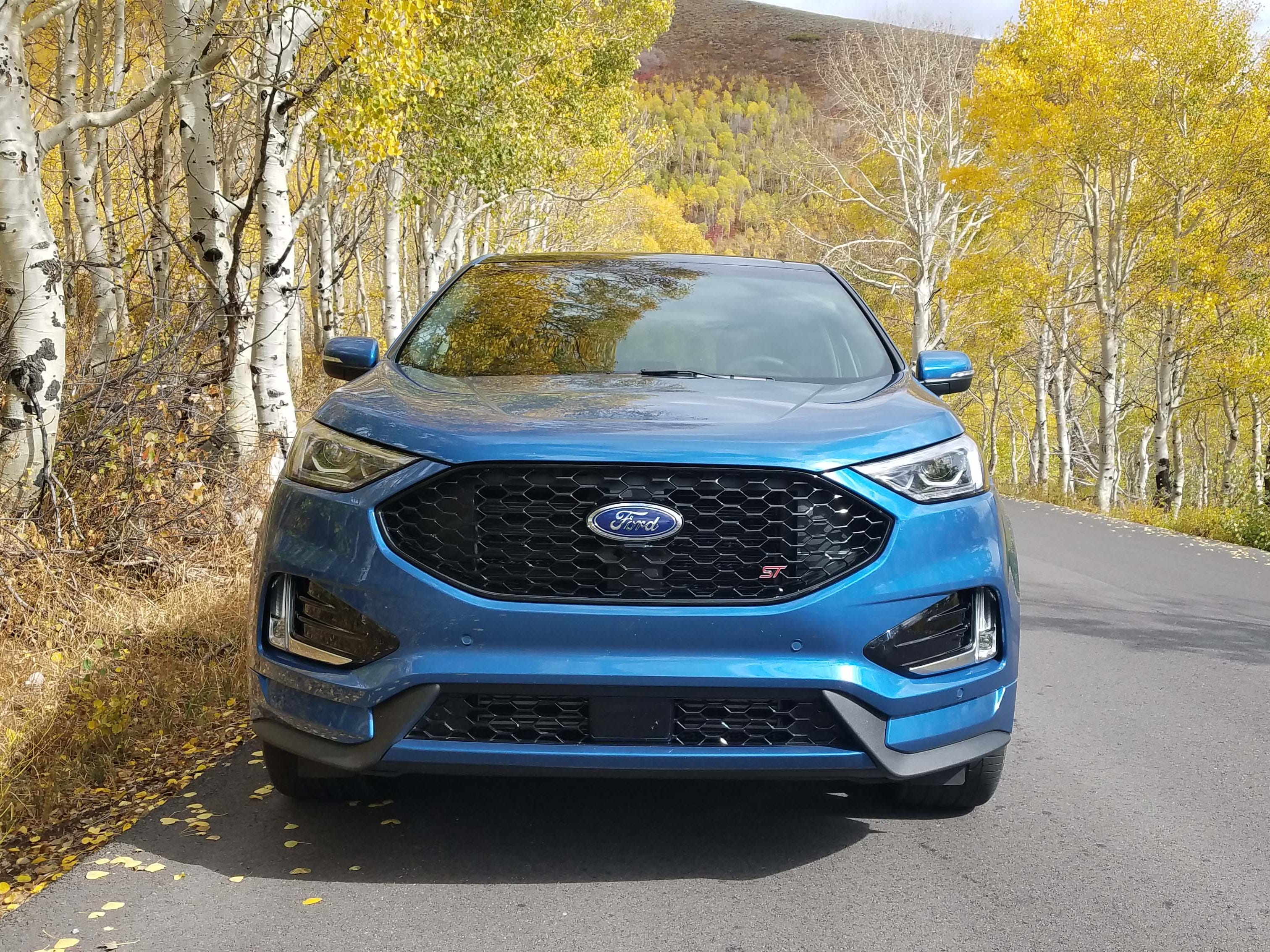 The 2019 Ford Edge ST's front fascia is different than the standard Edge with a black grille and lower intake.