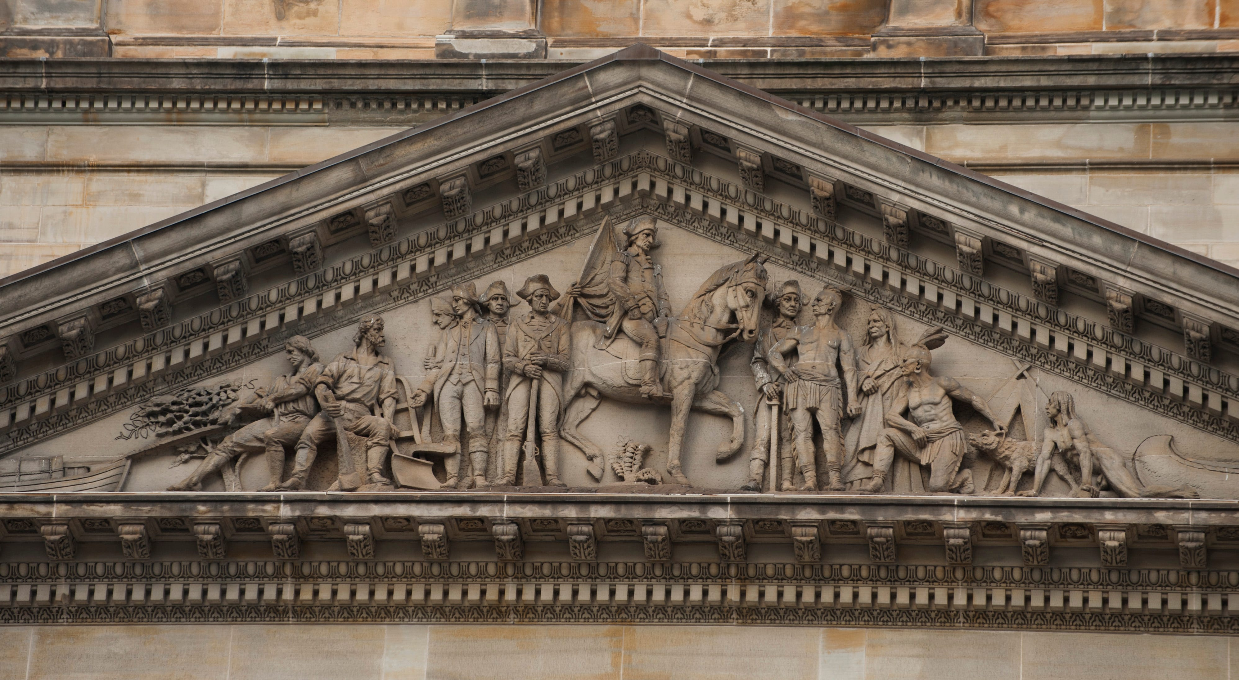 Above the main entrance on Randolph is a frieze showing Gen. Anthony Wayne, after whom the county is named, with soldiers, settlers and native Americans.