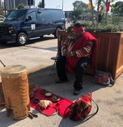 "Wayne Wilson of Arizona helped lead the ""Peace and Dignity"" ceremony at the first Indigenous Peoples' Day in Detroit."