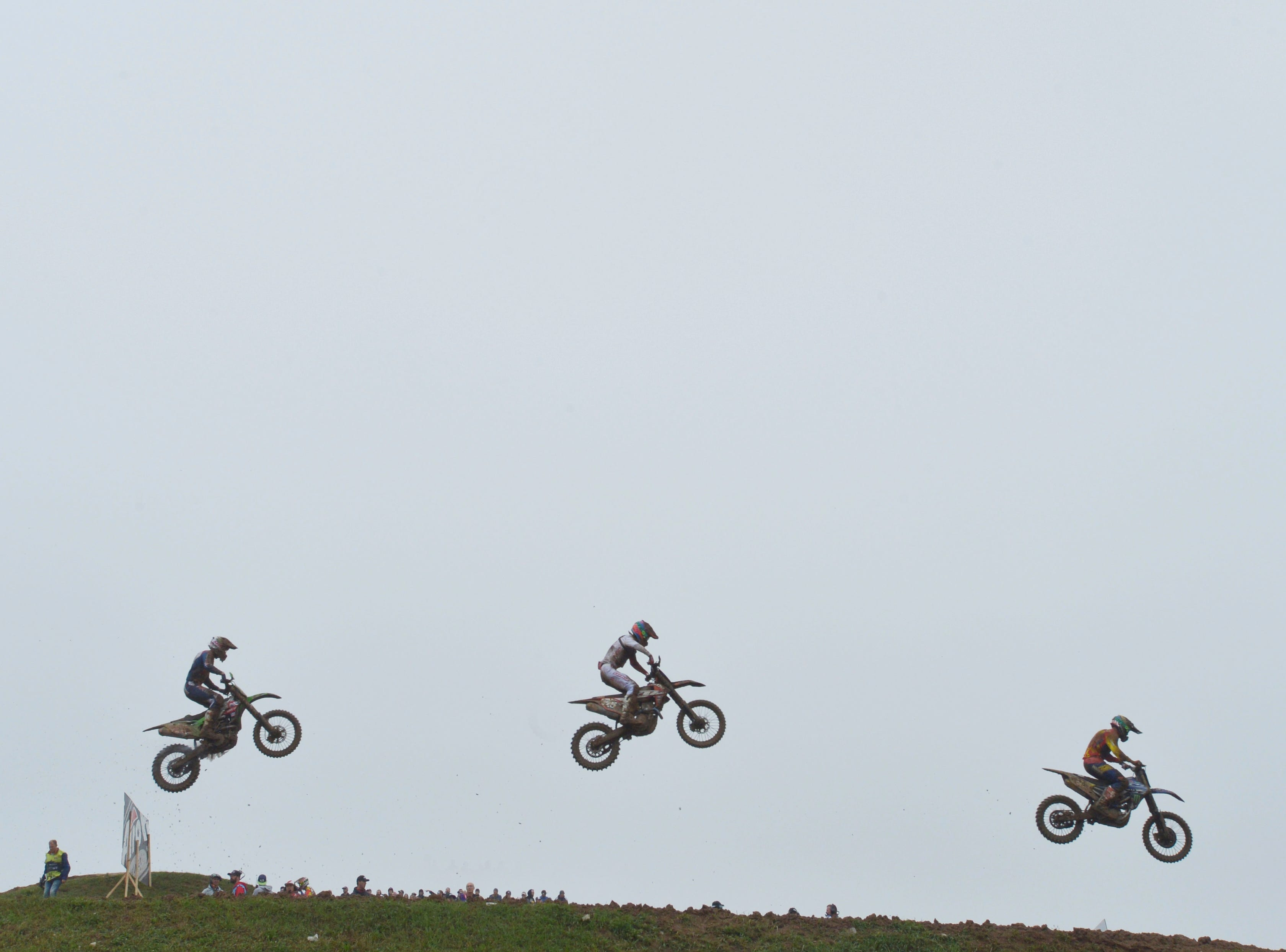 Riders fly over a jump during the first moto Sunday, Oct. 7, 2018, at the Motocross of Nations held at RedBud Mx in Buchanan, Mich.