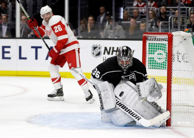 Kings goaltender Jack Campbell stops a shot in front of Red Wings' Thomas Vanek during the first period on Sunday.
