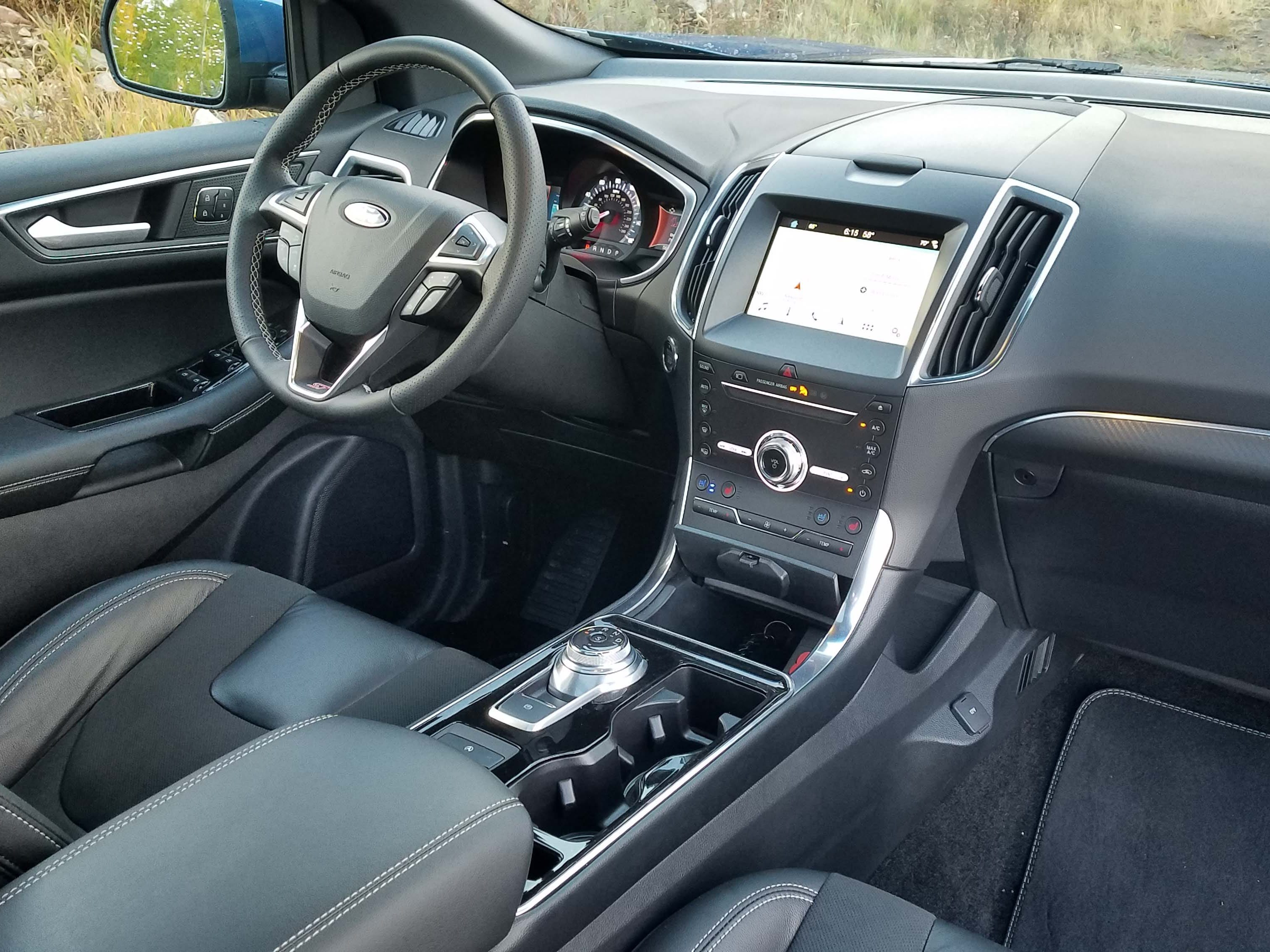 The interior of the 2019 Ford Edge ST is functional and comfortable with good cubby space (including atop the dash), connectivity, and posh seats. You can have any interior color you want as long as it's black.