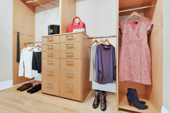 The existence of both short and long hang rods as well as drawers helps maximize this closet's functionality.