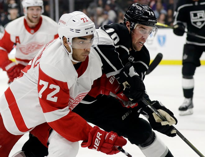 Detroit Red Wings' Andreas Athanasiou (72) is defended by Los Angeles Kings' Tanner Pearson (70) during the first period of an NHL hockey game Sunday, Oct. 7, 2018, in Los Angeles. (AP Photo/Marcio Jose Sanchez)