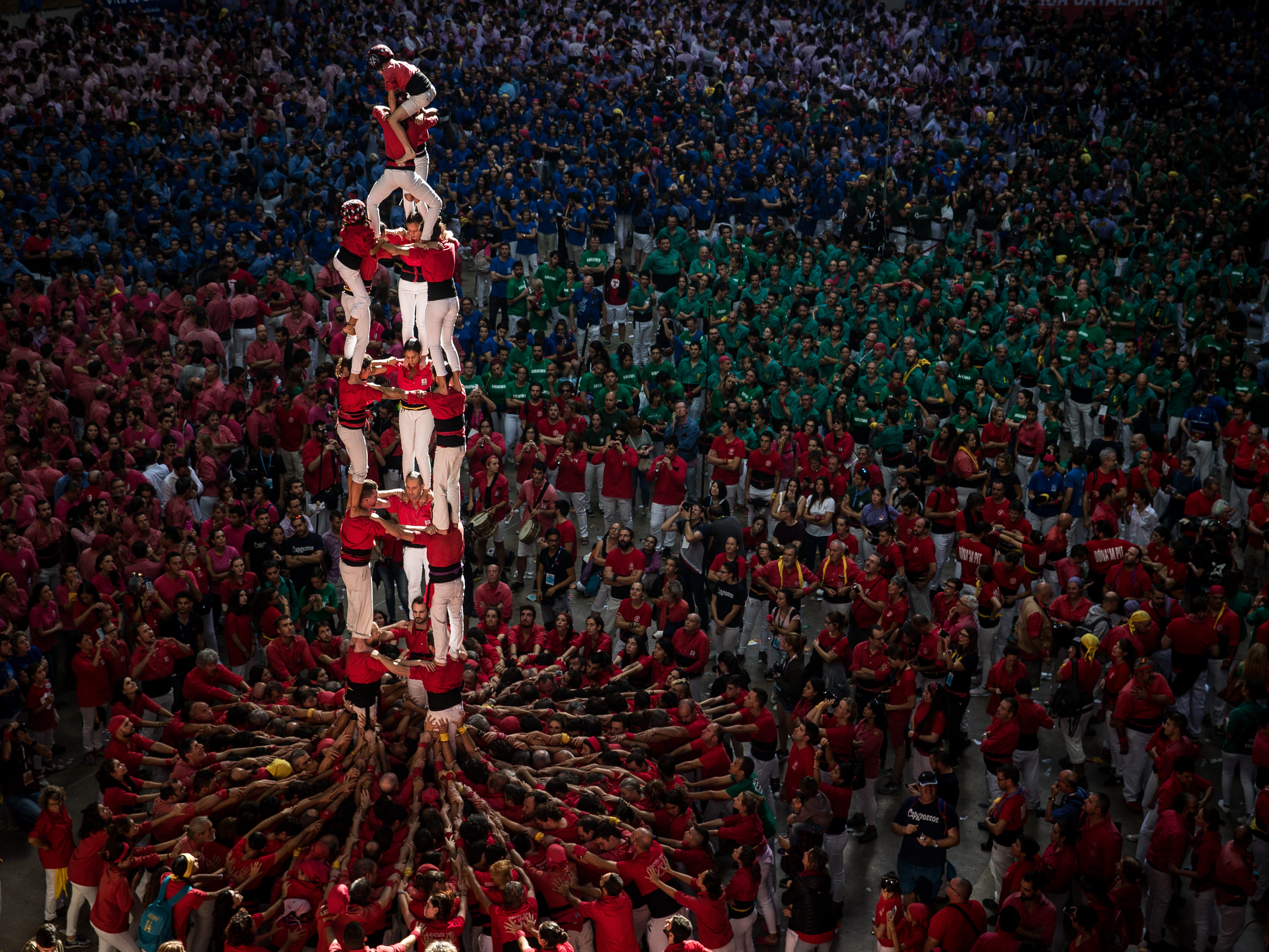 Members of the C. de Barcellona built a human tower during the 27th Tarragona Competition on October 07, 2018 in Tarragona, Spain. The 'Castellers' who build the human towers with precise techniques compete in groups, know as 'colles', at local fest
